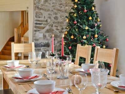 The dining area decked out for Christmas | Felin Hedd, Tregaron, near Aberystwyth
