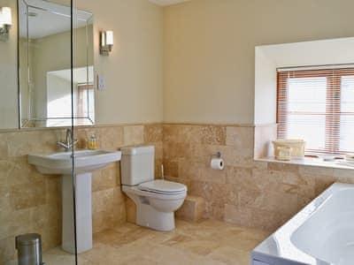 Stylish bathroom with separate shower cubicle | Felin Hedd, Tregaron, near Aberystwyth