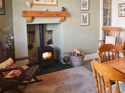 Dining room with log burner | Coble Cottage, Flamborough