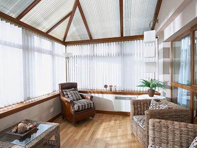 Pleasant conservatory/sun room | Summer Cottage, Brora