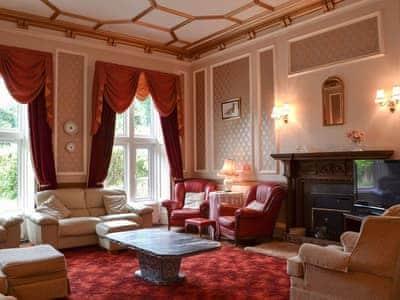 Impressive living room with many period features | Llys Y Craig, Near Penraeth