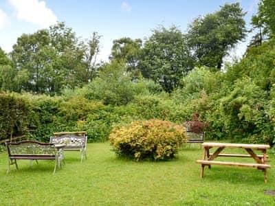 Garden with seating area | Llys Y Craig, Near Penraeth
