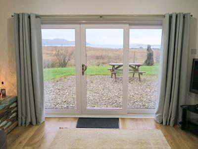 Living room with patio doors   Skylark Cottage, Upper Breakish, Isle of Skye
