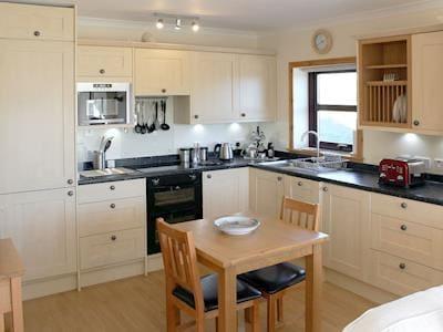 Kitchen/ dining area | Pine Tree Cottage, Altass, Lairg, Sutherland