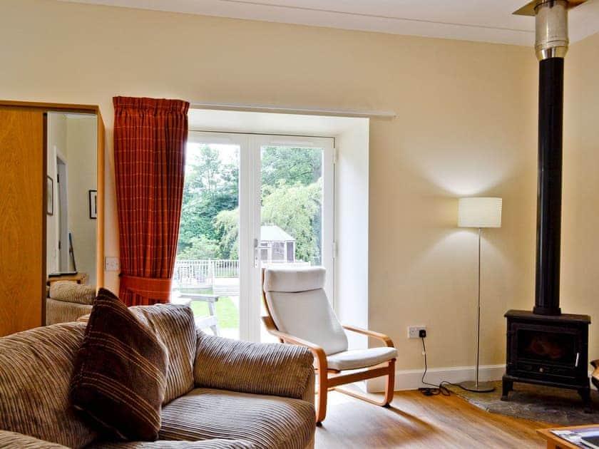 Open plan living/dining room/kitchen/bedroom | Auchendennan - Chestnut Cottage, Arden, Alexandria