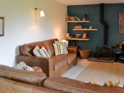 Living room with wood burner | Hollyhock Cottage, Thorns near Hawes