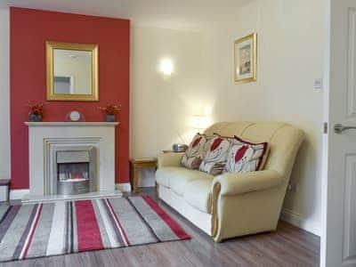 Comfy seating within lounge | 3 Greta Grove House - Greta Grove Apartments, Keswick