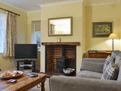 Beautifully presented living with woodburning stove  | Woodside Cottage, Thornthwaite