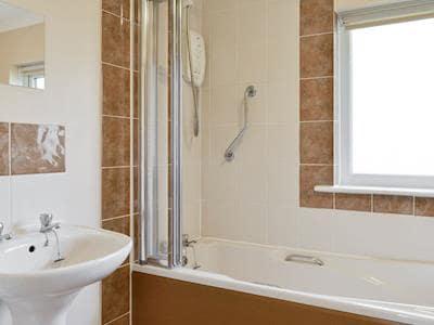 Family bathroom with shower over bath | White Pike, Threlkeld