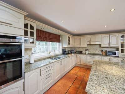 Excellent kitchen with wooden floors | Summer Cottage, Brora