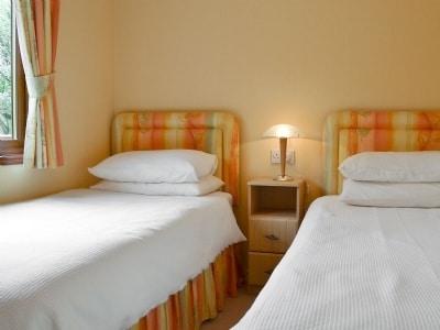 Twin bedroom | Lakeland Lodge, near Windermere