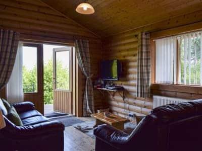 Open plan living/dining room/kitchen | Fingask Log Cabin, Glenfarg