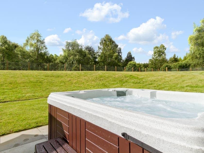 Enjoy a soak in your own private hot tub | Birch Corner, Aviemore