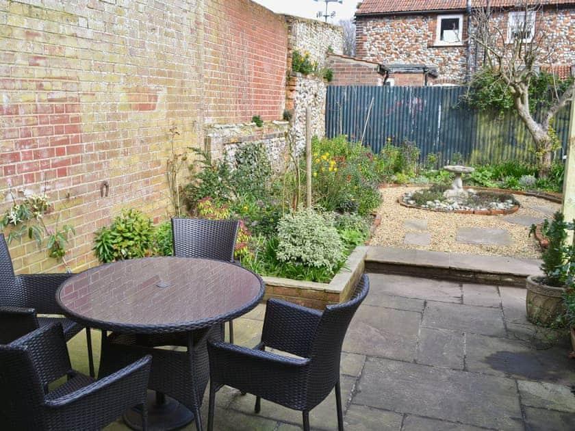Garden & outdoor sitting area | Pippin Cottage, Holt
